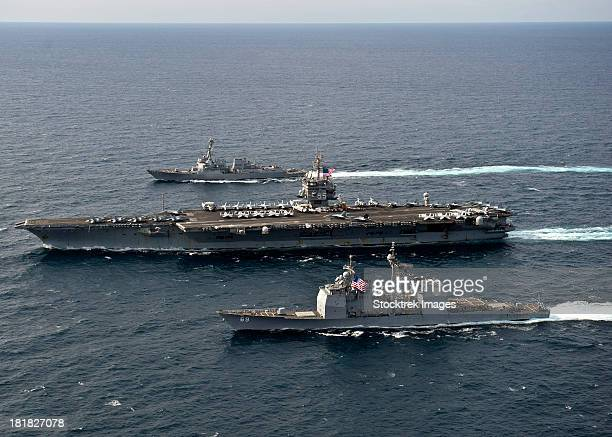 U.S. Navy ships transit the Atlantic Ocean.