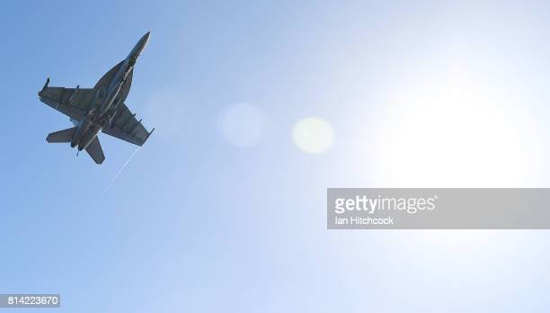 Navy Super Hornet flies over the deck of the USS Ronald Reagan on July 14 2017 in Townsville Australia USS Ronald Reagan is a 1092 foot aircraft...