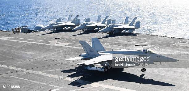 Navy Super Hornet lands on the deck of the USS Ronald Reagan on July 14 2017 in Townsville Australia USS Ronald Reagan is a 1092 foot aircraft...