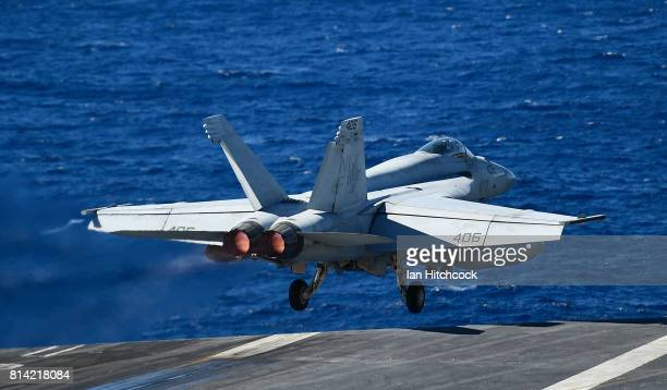 Navy Super Hornet takes off from the deck of the USS Ronald Reagan on July 14 2017 in Townsville Australia USS Ronald Reagan is a 1092 foot aircraft...