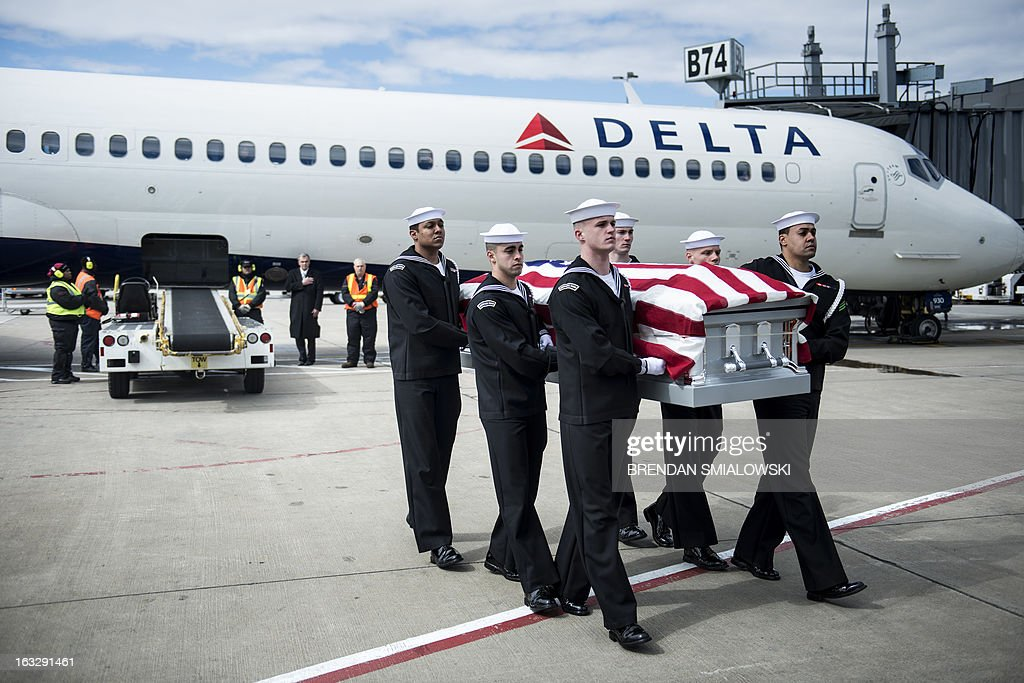 Navy transfer team carries the remains of an US Civil War casualty from Delta Flight 1172 during a dignified transfer at Dulles International Airport March 7, 2013 in Sterling, Virginia. The remains of two unknown soldiers found inside the sunken iron clad ship, the USS Monitor, were transfered for burial at Arlington National Cemetery after being discovered in 2002 and being sent to Joint POW/MIA Accounting Command in Hawaii for possible genetic identification. AFP PHOTO/Brendan SMIALOWSKI