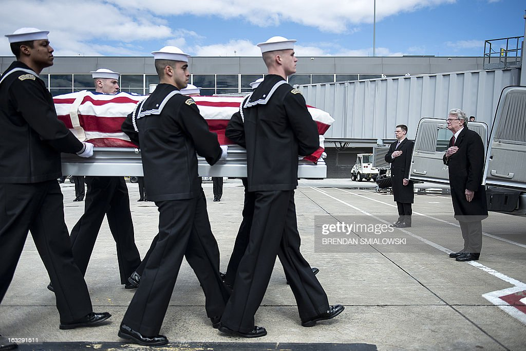 Navy transfer team carries the remains of an US Civil War (1861-1865) casualty from Delta Flight 1172 to a hearse during a dignified transfer at Dulles International Airport March 7, 2013 in Sterling, Virginia. The remains of two unknown soldiers found inside the sunken iron clad ship, the USS Monitor, were transfered for burial at Arlington National Cemetery after being discovered in 2002 and being sent to Joint POW/MIA Accounting Command in Hawaii for possible genetic identification. AFP PHOTO/Brendan SMIALOWSKI