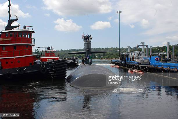 Navy tugboats move the Los Angelesclass attack submarine USS Providence away from the piers August 26 2011 in Groton Connecticut The submarine was...