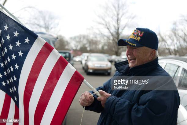 Navy Veteran Ed Knox of the Somerton neighborhood in Northeast Philadelphia prepares an American Flag which once belong to his late brother inlaw...
