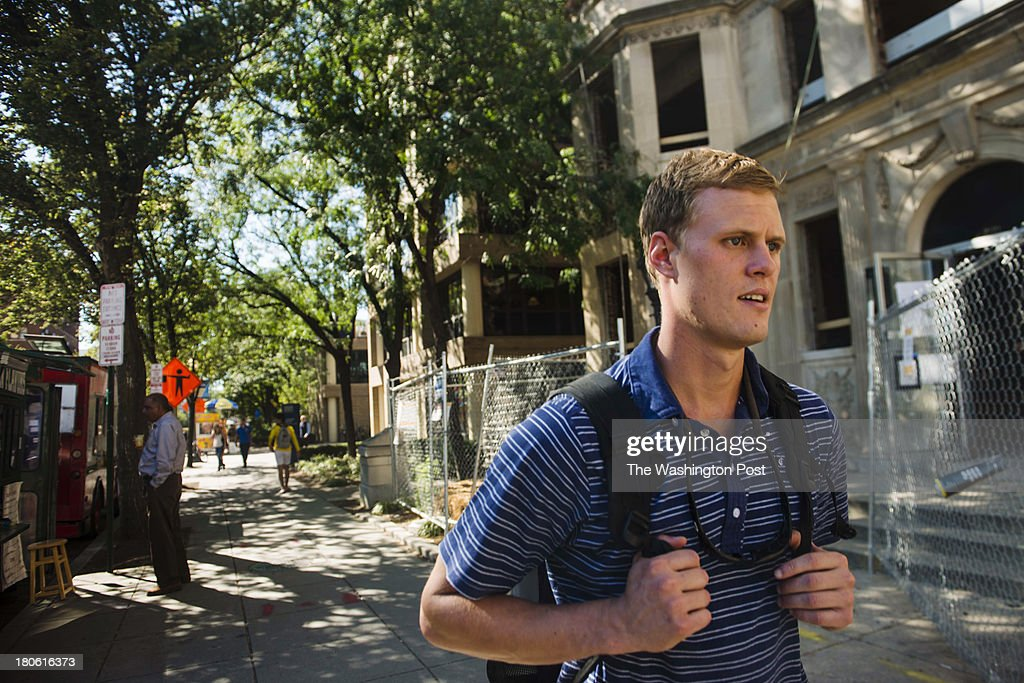 Navy veteran Nathan Sable, 26, walks to his job at the Office of Military and Veterans student services at George Washington University on Friday, Sept. 6, 2013 in Washington, DC. After 7 years in the service Sable decided to return to school to get his degree.