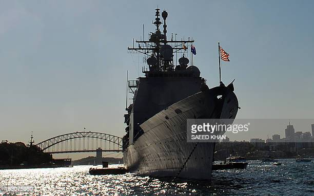 US navy warship forwarddeployed Ticonderogaclass cruiser USS Chosin docks at the Sydney Harbour in front of the Harbour Bridge on October 4 2013...