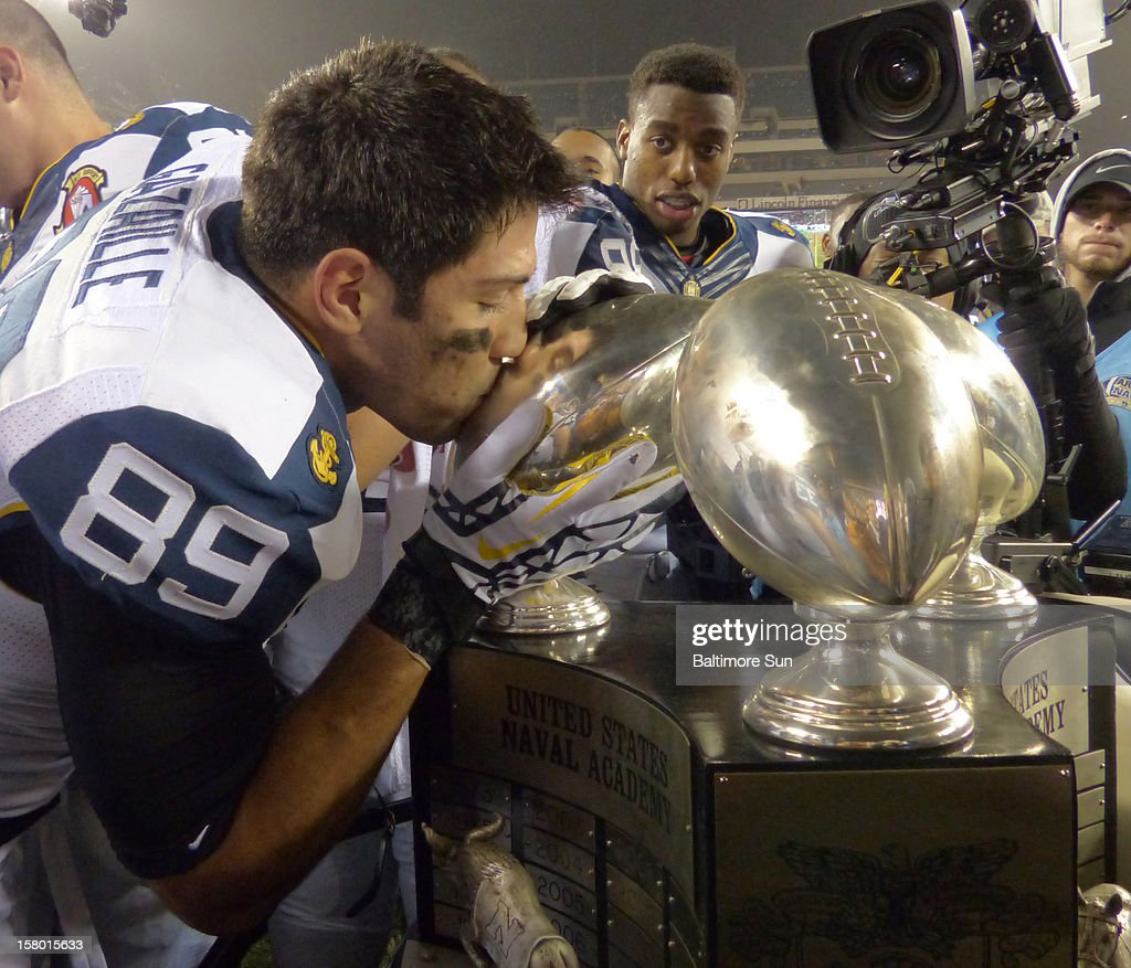 Navy wide receiver Jonathan Gazaille (89) kisses the Commander-in-Chief's Trophy after Navy's 17-13 win over Army on Saturday, December 8, 2012, in Philadelphia, Pennsylvania.