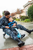 Navy Woman at home with young son