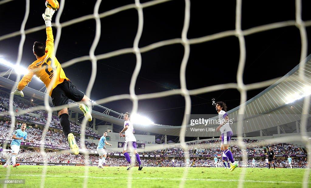 Nawaf Al Khaldi of Al Ain saves a shot on goal during the friendly match between Al Ain and Manchester City at Hazza bin Zayed Stadium on May 15, 2014 in Al Ain, United Arab Emirates.