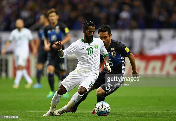 Nawaf Alabid of Saudi Arabia and Yuto Nagatomo of Japan compete for the ball during the 2018 FIFA World Cup Qualifier match between Japan and Saudi...