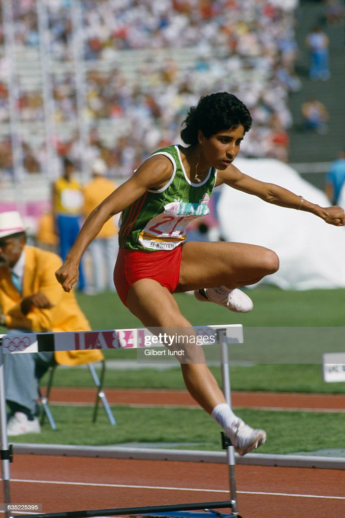 Nawal el Moutawakel of Morocco during the Women's 400-meter hurdles. She became the first Muslim and African female Olympic champion.