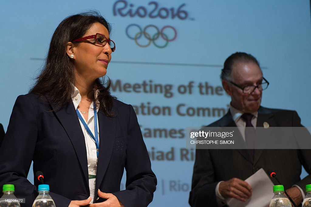 Nawal El Moutawakel (L), president of the Coordination Commission of the Rio 2016 Olympics and Carlos Arthur Nuzman, president of the Organisation Committee, arrive for a presser of the 4th meeting of the organism, in Rio de Janeiro, Brazil, on February 20, 2013. AFP PHOTO / Christophe Simon