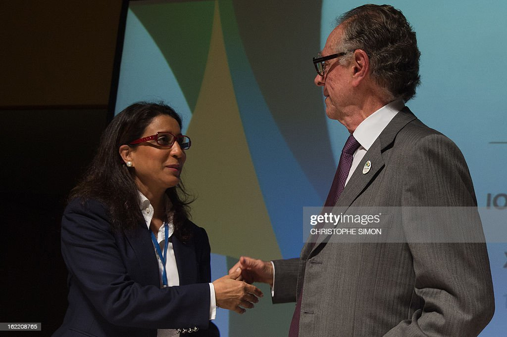 Nawal El Moutawakel (L), president of the Coordination Commission of the Rio 2016 Olympics shakes hands with Carlos Arthur Nuzman, president of the Organisation Committee, during a presser of the 4th meeting of the organism, in Rio de Janeiro, Brazil, on February 20, 2013. AFP PHOTO / Christophe Simon