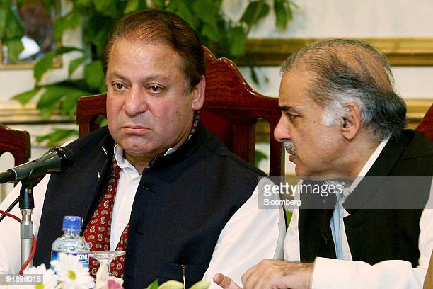 Nawaz Sharif Pakistan's former prime minister left and his brother Shehbaz Sharif chair a meeting of newly elected parliamentarians from his party...