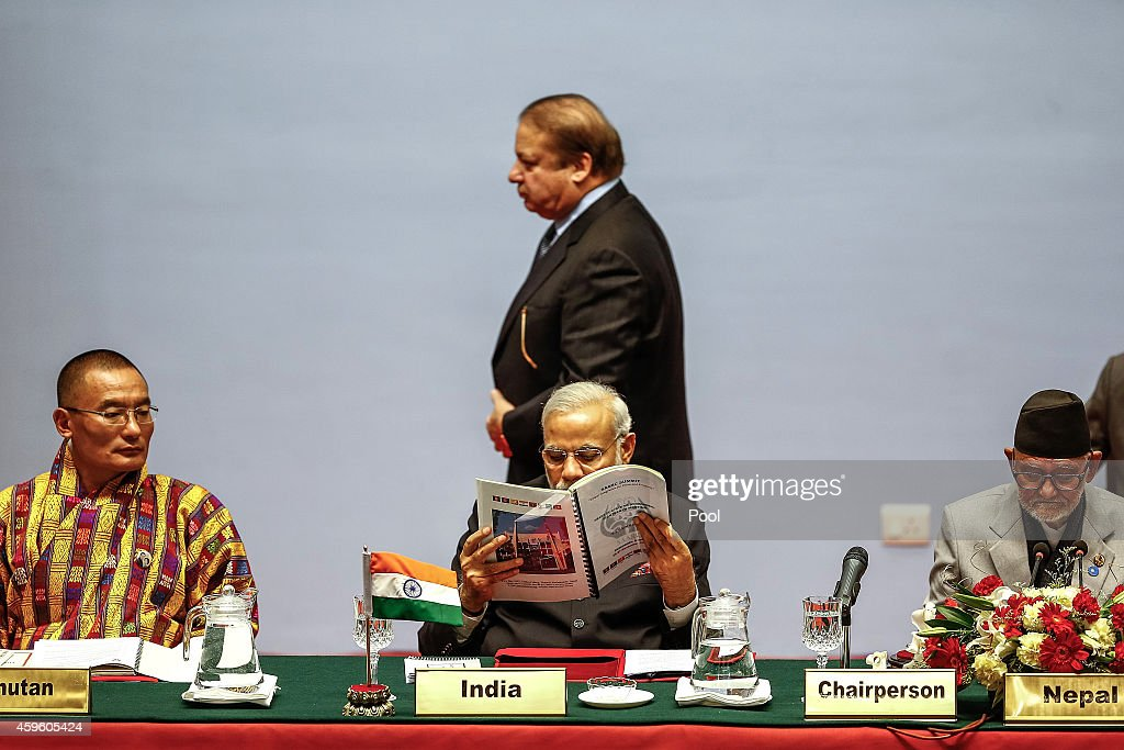 <a gi-track='captionPersonalityLinkClicked' href=/galleries/search?phrase=Nawaz+Sharif&family=editorial&specificpeople=217726 ng-click='$event.stopPropagation()'>Nawaz Sharif</a>, Prime Minister of Pakistan, walks behind Indian Prime Minister <a gi-track='captionPersonalityLinkClicked' href=/galleries/search?phrase=Narendra+Modi&family=editorial&specificpeople=822611 ng-click='$event.stopPropagation()'>Narendra Modi</a> during the inaugural session of the 18th SAARC Summit on November 26, 2014 in Kathmandu, Nepal. Nepal is hosting the 18th South Asian Association for Regional Cooperation (SAARC) Summit in Kathmandu, which will be attended by leaders of Afghanistan, Bangladesh, Pakistan, India, the Maldives, Sri Lanka, Bhutan and Nepal. Nepal is hosting the SAARC Summit for the third time, which was first held in Dhaka, Bangladesh in 1985. Some of the key issues to be discussed during the Summit will include three key framework agreements between SAARC countries to enhance rail and road connectivity and to set up a regional power grid.