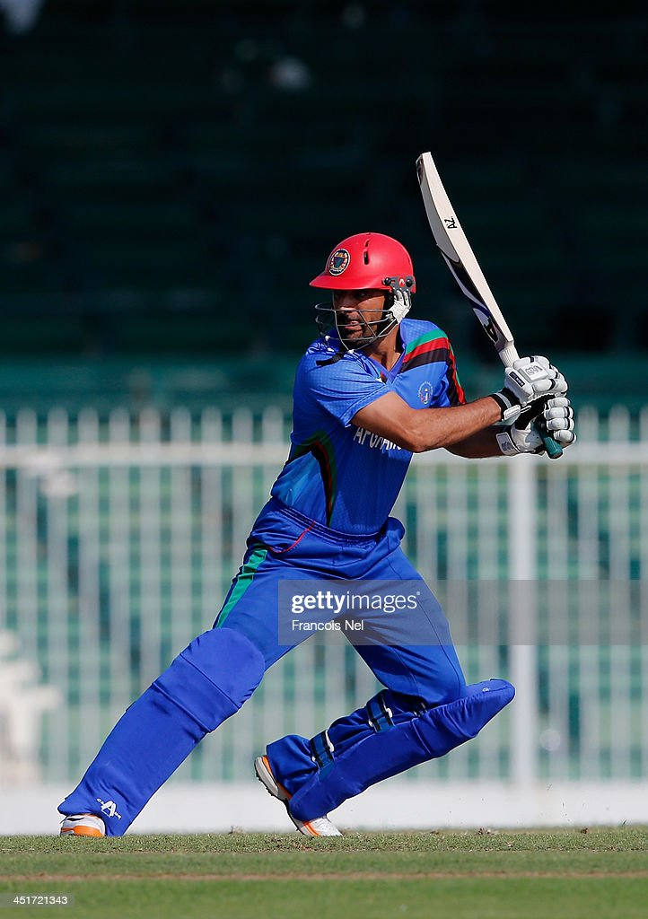 <a gi-track='captionPersonalityLinkClicked' href=/galleries/search?phrase=Nawroz+Mangal&family=editorial&specificpeople=5794122 ng-click='$event.stopPropagation()'>Nawroz Mangal</a> bats during the ICC World Twenty20 Qualifier between Afghanistan and Kenya at the Sharjah Cricket Stadium on November 24, 2013 in Dubai, United Arab Emirates.