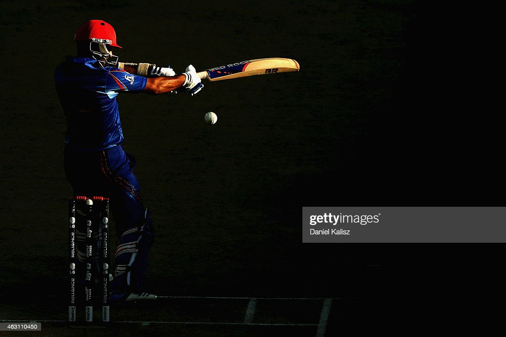 <a gi-track='captionPersonalityLinkClicked' href=/galleries/search?phrase=Nawroz+Mangal&family=editorial&specificpeople=5794122 ng-click='$event.stopPropagation()'>Nawroz Mangal</a> of Afghanistan bats during the 2015 ICC Cricket World Cup warm up match between India and Afghanistan at Adelaide Oval on February 10, 2015 in Adelaide, Australia.