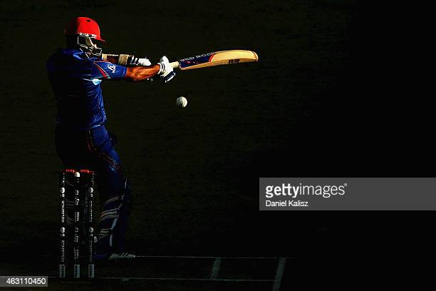 Nawroz Mangal of Afghanistan bats during the 2015 ICC Cricket World Cup warm up match between India and Afghanistan at Adelaide Oval on February 10...