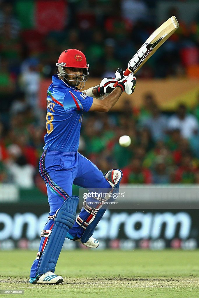 <a gi-track='captionPersonalityLinkClicked' href=/galleries/search?phrase=Nawroz+Mangal&family=editorial&specificpeople=5794122 ng-click='$event.stopPropagation()'>Nawroz Mangal</a> of Afghanistan bats during the 2015 ICC Cricket World Cup match between Bangladesh and Afghanistan at Manuka Oval on February 18, 2015 in Canberra, Australia.