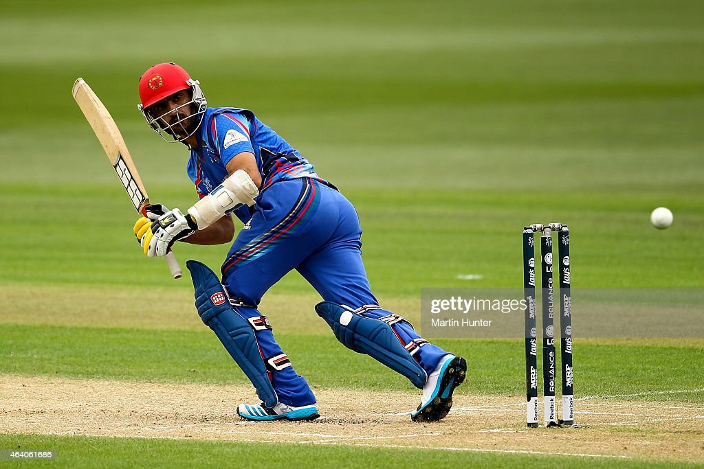 <a gi-track='captionPersonalityLinkClicked' href=/galleries/search?phrase=Nawroz+Mangal&family=editorial&specificpeople=5794122 ng-click='$event.stopPropagation()'>Nawroz Mangal</a> of Afghanistan bats during the 2015 ICC Cricket World Cup match between Sri Lanka and Afghanistan at University Oval on February 22, 2015 in Dunedin, New Zealand.