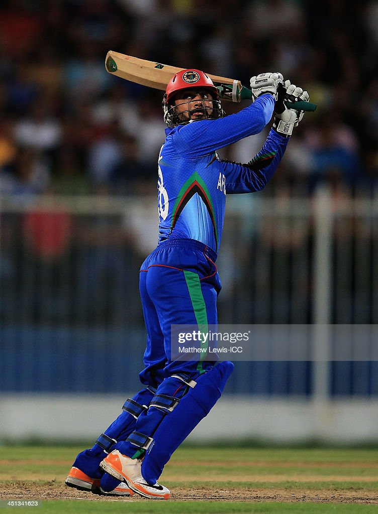 <a gi-track='captionPersonalityLinkClicked' href=/galleries/search?phrase=Nawroz+Mangal&family=editorial&specificpeople=5794122 ng-click='$event.stopPropagation()'>Nawroz Mangal</a> of Afghanistan hits a six during the ICC World Twenty20 Qualifier between Afghanistan and Nepal at the Sharjah Cricket Stadium on November 22, 2013 in Dubai, United Arab Emirates.