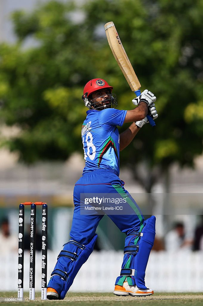<a gi-track='captionPersonalityLinkClicked' href=/galleries/search?phrase=Nawroz+Mangal&family=editorial&specificpeople=5794122 ng-click='$event.stopPropagation()'>Nawroz Mangal</a> of Afghanistan hits the ball towards the boundary during the ICC World Twenty20 Qualifier match between Afghanistan and Bermuda at the ICC Academy on November 20, 2013 in Dubai, United Arab Emirates.