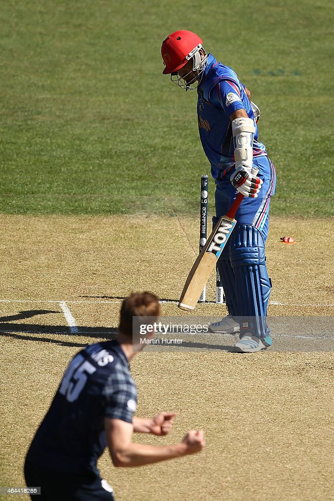 <a gi-track='captionPersonalityLinkClicked' href=/galleries/search?phrase=Nawroz+Mangal&family=editorial&specificpeople=5794122 ng-click='$event.stopPropagation()'>Nawroz Mangal</a> of Afghanistan reacts after being bowled by Alisdair Evans of Scotland during the 2015 ICC Cricket World Cup match between Afghanistan and Scotland at University Oval on February 26, 2015 in Dunedin, New Zealand.