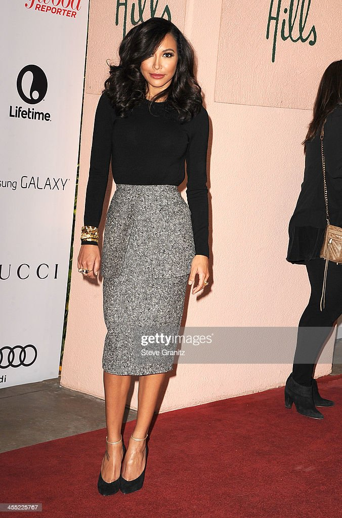 Naya Rivera arrives at the The Hollywood Reporter's Women In Entertainment Breakfast Honoring Oprah Winfrey at Beverly Hills Hotel on December 11, 2013 in Beverly Hills, California.