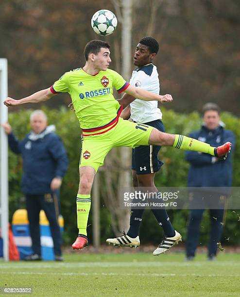 Nayair Tiknizyan of CSKA Moscow and Timothy Eyoma of Tottenham Hotspur jump for the ball during the UEFA Youth Champions League match between...
