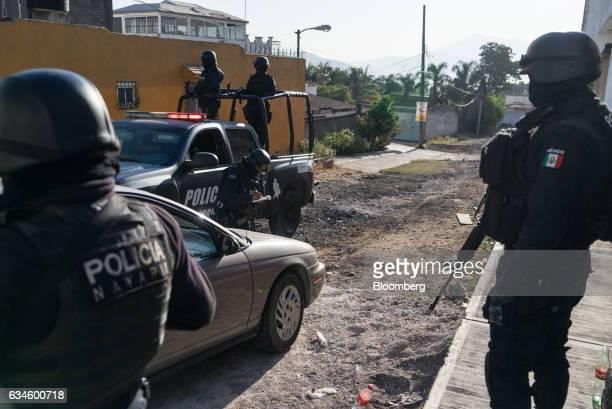 Nayarit police officers block off an area near where forces killed Juan Francisco Patrón Sánchez leader of the Beltran Leyva Cartel the night before...