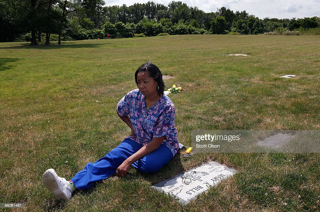Naykysha Morgan Sits By The Grave Of Her Mother At Mount Glenwood Memory Gardens Cemetery July