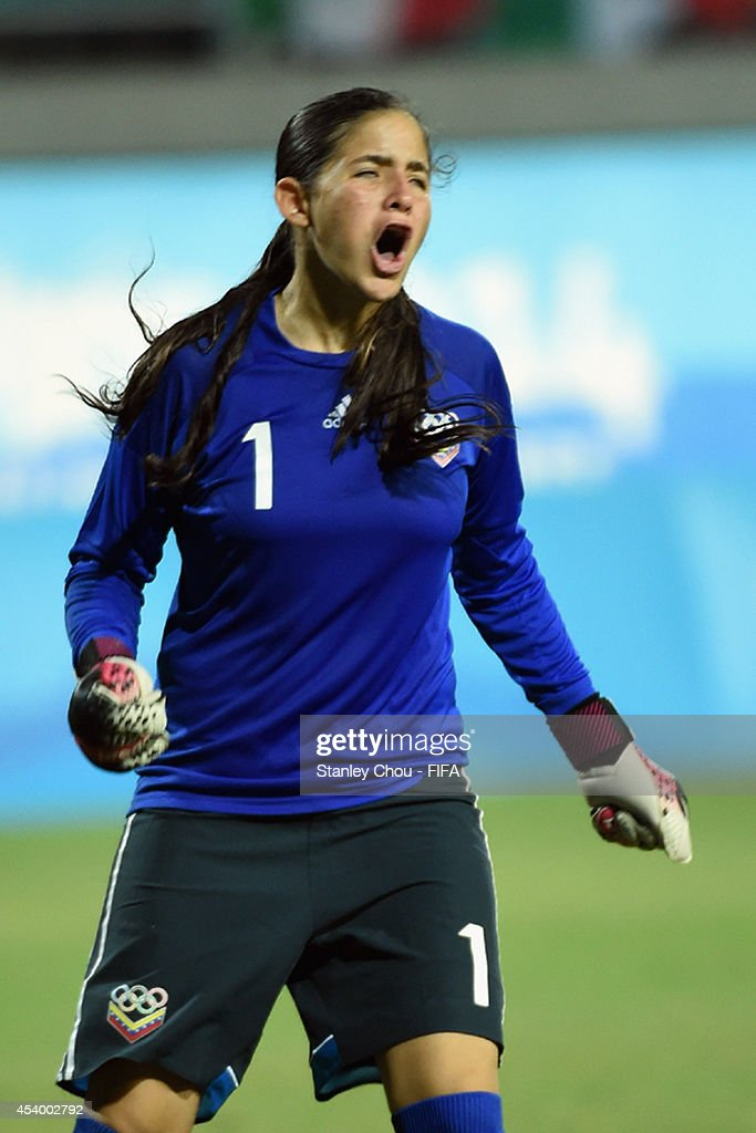 Nayluisa Caceres of Venezuela celebrates after she converted the winning penalty to defeat Mexico 4-3 in the penalty shoot out during the 2014 FIFA Girls Summer Youth Olympic Football Tournament Semi Final match between Venezuela and Mexico at Wutaishan Stadium on August 23, 2014 in Nanjing, China.