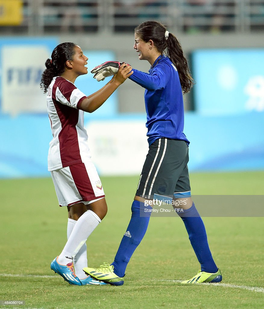 Nayluisa Caceres of Venezuela celebrates with Nathalie Pasquel after she converted the winning penalty to defeat Mexico 4-3 in the penalty shoot out during the 2014 FIFA Girls Summer Youth Olympic Football Tournament Semi Final match between Venezuela and Mexico at Wutaishan Stadium on August 23, 2014 in Nanjing, China.