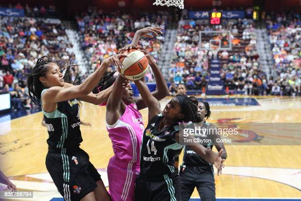Nayo RaincockEkunwe of the New York Liberty Jonquel Jones of the Connecticut Sun and Sugar Rodgers of the New York Liberty challenge for a rebound...