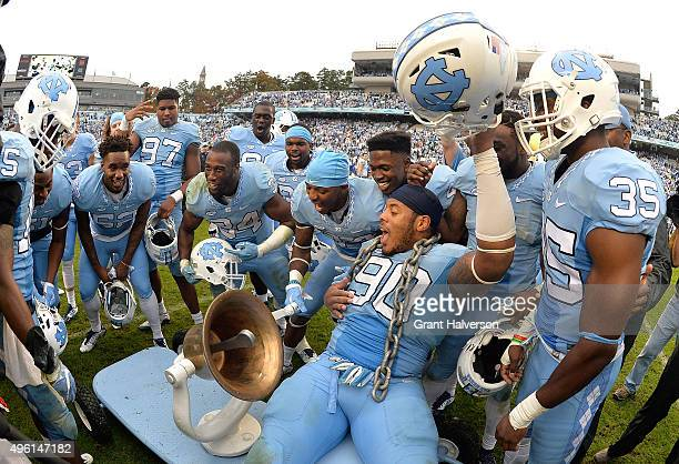 Nazair Jones of the North Carolina Tar Heels celebrates with teammates after their win against the Duke Blue Devils at Kenan Stadium on November 7...