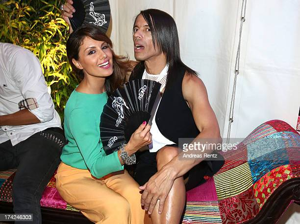 Nazan Eckes and Jorge Gonzalez attend KARE Design at the New Faces Award Fashion 2013 at Rheinterrasse on July 22 2013 in Duesseldorf Germany