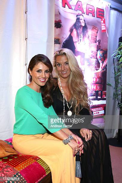 Nazan Eckes and Olivia Schoenhofen attend KARE Design at the New Faces Award Fashion 2013 at Rheinterrasse on July 22 2013 in Duesseldorf Germany