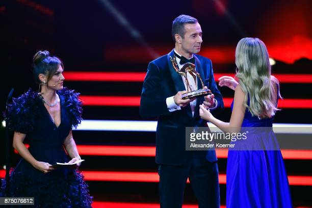 Nazan Eckes 'Best Host' BAMBI Audience Award Winner Kai Pflaume and Miss BAMBI 2017 Laura Stefa on stage during the Bambi Awards 2017 show at Stage...