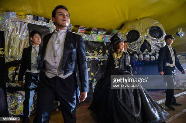 Nazareth Llubere Sanabria dances during the celebration of her fifteenth birthday by paying homage to Santa Muerte in Metepec Mexico State on...