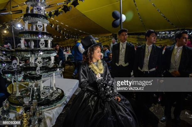 Nazareth Llubere Sanabria is pictured during the celebration of her fifteenth birthday by paying homage to Santa Muerte in Metepec Mexico State on...