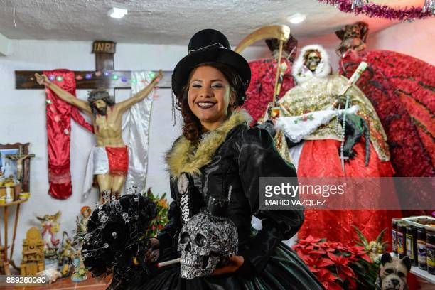 Nazareth Llubere Sanabria poses for the picture during the celebration of her fifteenth birthday by paying homage to Santa Muerte in Metepec Mexico...