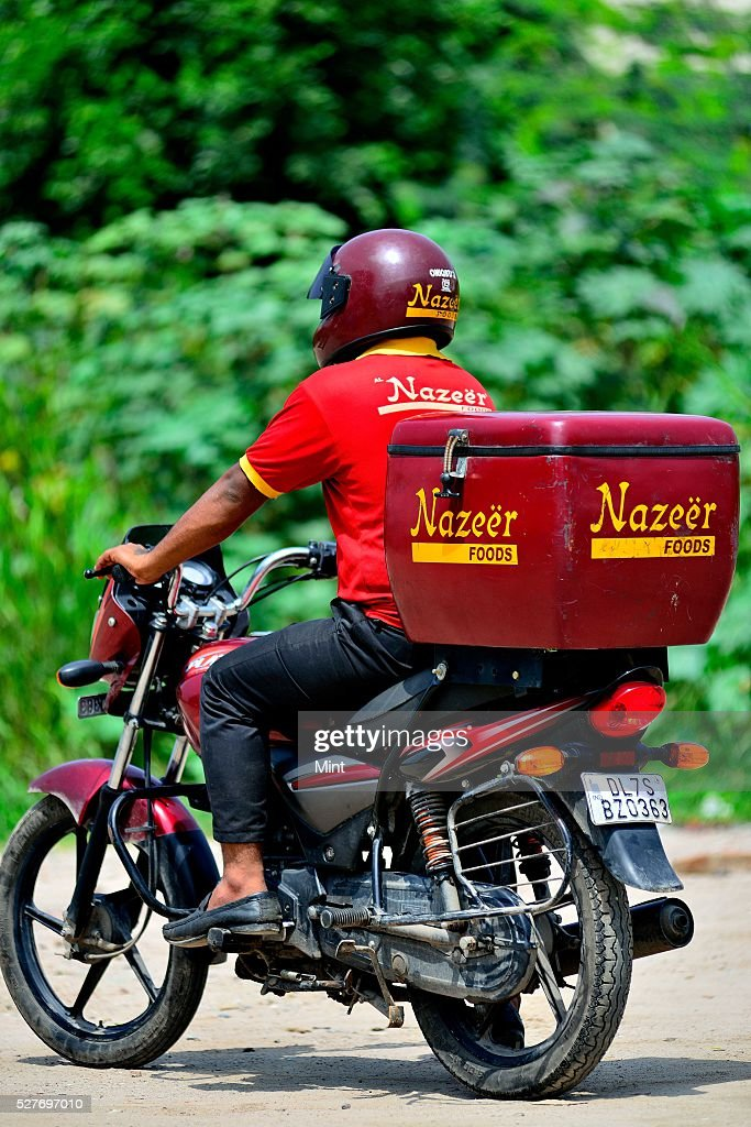 Nazeer Food providing Home Delivery Service to their customers on August 26, 2015 in New Delhi, India.