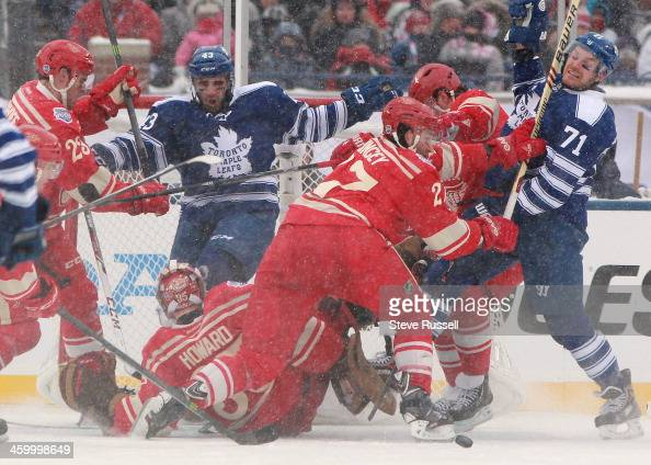 ANN ARBOR MI JANUARY 1 Nazem Kadri and David Clarkson battle for position in front of the net as the Toronto Maple Leafs beat the Detroit Red Wings...