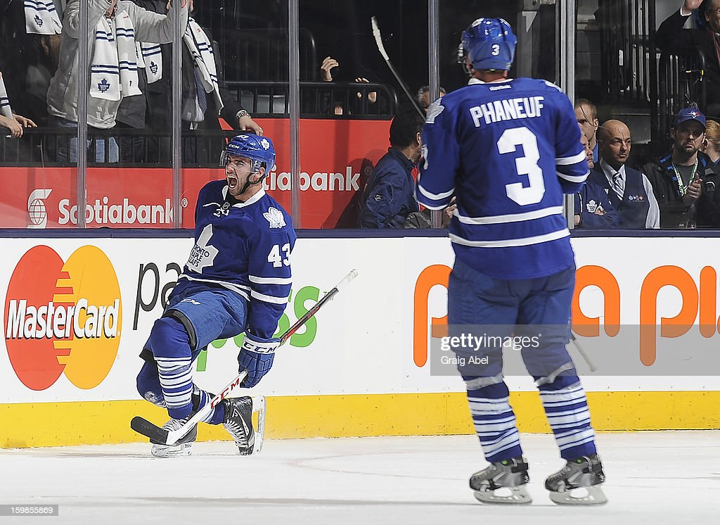 <a gi-track='captionPersonalityLinkClicked' href=/galleries/search?phrase=Nazem+Kadri&family=editorial&specificpeople=4043234 ng-click='$event.stopPropagation()'>Nazem Kadri</a> #43 and <a gi-track='captionPersonalityLinkClicked' href=/galleries/search?phrase=Dion+Phaneuf&family=editorial&specificpeople=545455 ng-click='$event.stopPropagation()'>Dion Phaneuf</a> #3 of the Toronto Maple Leafs celebrate a third period goal during NHL game action against the Buffalo Sabres January 21, 2013 at the Air Canada Centre in Toronto, Ontario, Canada.