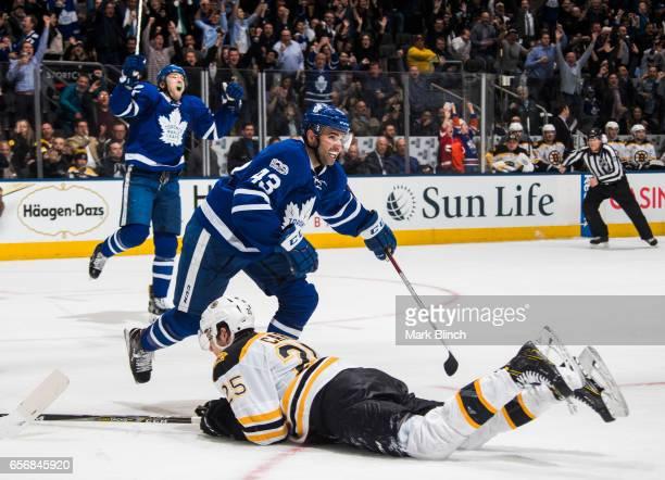 Nazem Kadri and James van Riemsdyk of the Toronto Maple Leafs celebrate a goal on Tuukka Rask of the Boston Bruins scored by Tyler Bozal during the...