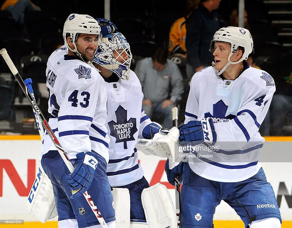 <a gi-track='captionPersonalityLinkClicked' href=/galleries/search?phrase=Nazem+Kadri&family=editorial&specificpeople=4043234 ng-click='$event.stopPropagation()'>Nazem Kadri</a> #43 and <a gi-track='captionPersonalityLinkClicked' href=/galleries/search?phrase=Morgan+Rielly&family=editorial&specificpeople=8050727 ng-click='$event.stopPropagation()'>Morgan Rielly</a> #44 of the Toronto Maple Leafs congratulate teammate goalie <a gi-track='captionPersonalityLinkClicked' href=/galleries/search?phrase=Jonathan+Bernier&family=editorial&specificpeople=540491 ng-click='$event.stopPropagation()'>Jonathan Bernier</a> #45 after a victory over the Nashville Predators at Bridgestone Arena on October 10, 2013 in Nashville, Tennessee.