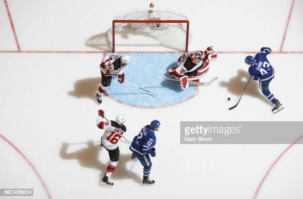 Nazem Kadri and Patrick Marleau of the Toronto Maple Leafs go to the net against Cory Schneider Steven Santini and Miles Wood of the New Jersey...
