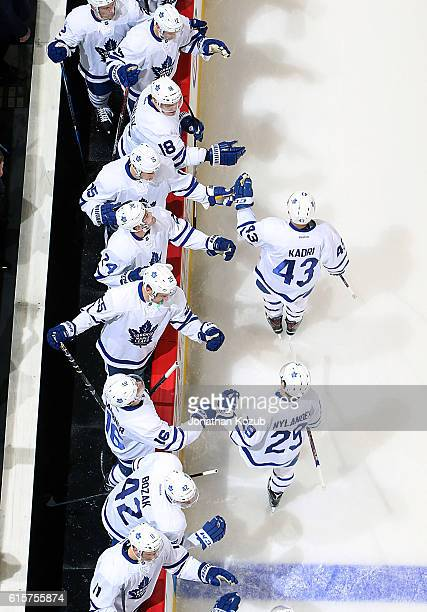 Nazem Kadri and William Nylander of the Toronto Maple Leafs celebrate a second period goal against the Winnipeg Jets with teammates at the bench at...
