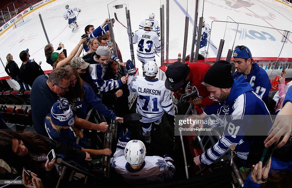 Nazem Kadri David Clarkson and Daniel Winnik of the Toronto Maple Leafs take the ice for warm ups to the NHL game against the Arizona Coyotes at Gila...