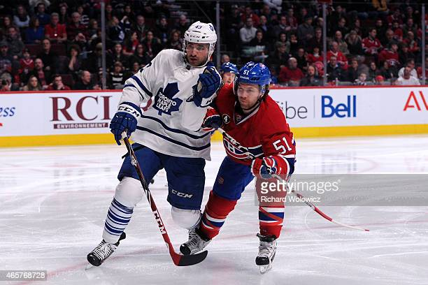 Nazem Kadri of the Toronto Maple Leafs and David Desharnais of the Montreal Canadiens battle for position during the NHL game at the Bell Centre on...